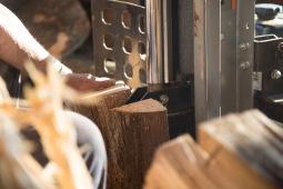 Richard Kinard splits wood before selling it at his wood shed.