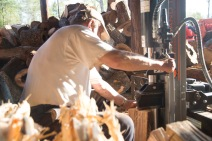 Richard Kinard splits wood before selling it at his wood shed. Documentary
