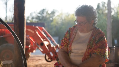 Ruth Kinard, Richard's wife, visits the wood shed to chat with her husband about his day.